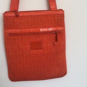Michael Kors adjustable crossbody bag.